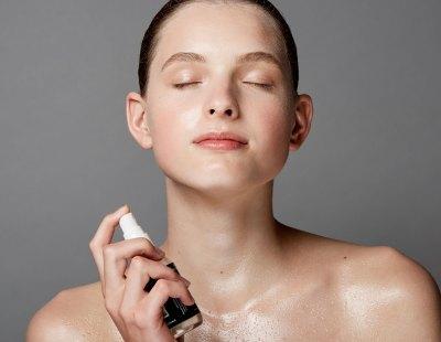 girl spraying face toner