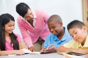 Female educator assisting three students
