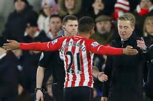 Ryan Bertrand receiving a red card for his
