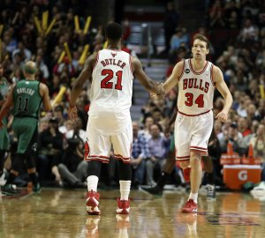 Right, Chicago Bulls forward Mike Dunleavy (34), with Chicago Bulls guard Chicago Bulls forward Mike Dunleavy (34), right, is congratulated by Chicago Bulls guard Jimmy Butler (21) after making a three-point basket against the Boston Celtics during the second half at the United Center in Chicago on Monday, March 31, 2014. (Nuccio DiNuzzo/Chicago Tribune/MCT via Getty Images)