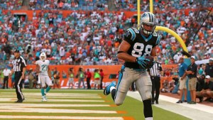 MIAMI GARDENS, FL - NOVEMBER 24: Greg Olsen #88 of the Carolina Panthers catches a game winning touchdown during a game against the Miami Dolphins at Sun Life Stadium on November 24, 2013 in Miami Gardens, Florida.  (Photo by Mike Ehrmann/Getty Images)