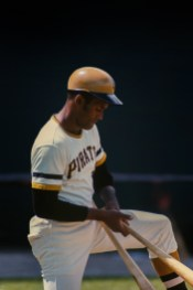 Roberto Clemente on deck readying his baseball bat.
