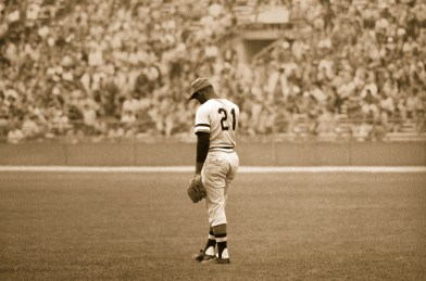 Roberto Clemente pauses for a moment in the outfield. Chicago, circa 1971