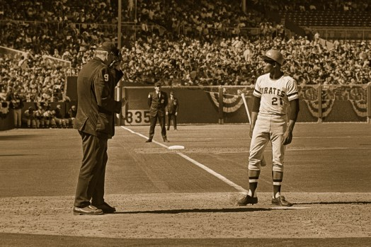 Clemente pauses during a World Series game.
