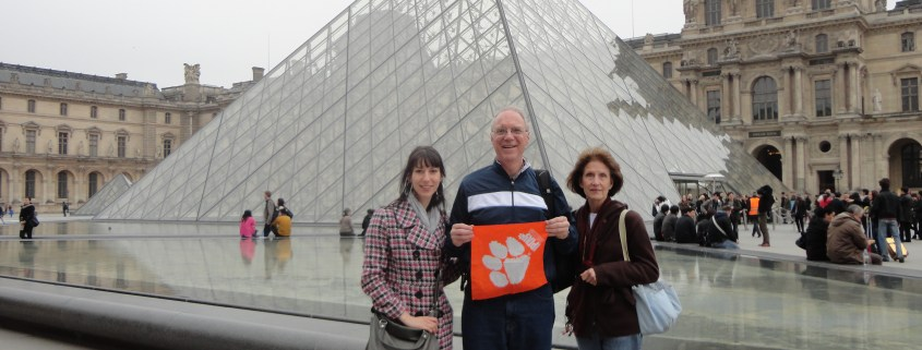 France - Mike '75 and Ellen Mathis '75 Webber, with daughter Martha, the Louvre in Paris.