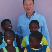 Joseph Mizzi '88, with children in Zambia, where construction began this spring on Chipakata Children's Academy.