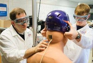 Assistant professor of bioengineering David Kwartowitz works with a student Creative Inquiry team conducting research to prevent sports concussions.