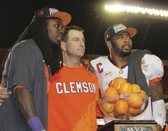 Coach Swinney, Sammy Watkins and Taj Boyd on the podium after the Orange Bowl win.