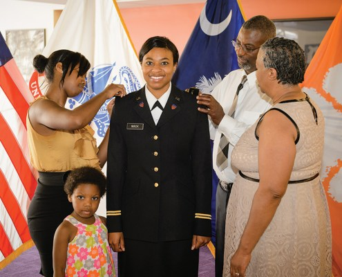Sharosca Mack '14, an economics major from Loris, was commissioned as a second lieutenant in the Army at a joint Army and Air Force ceremony on May 8.