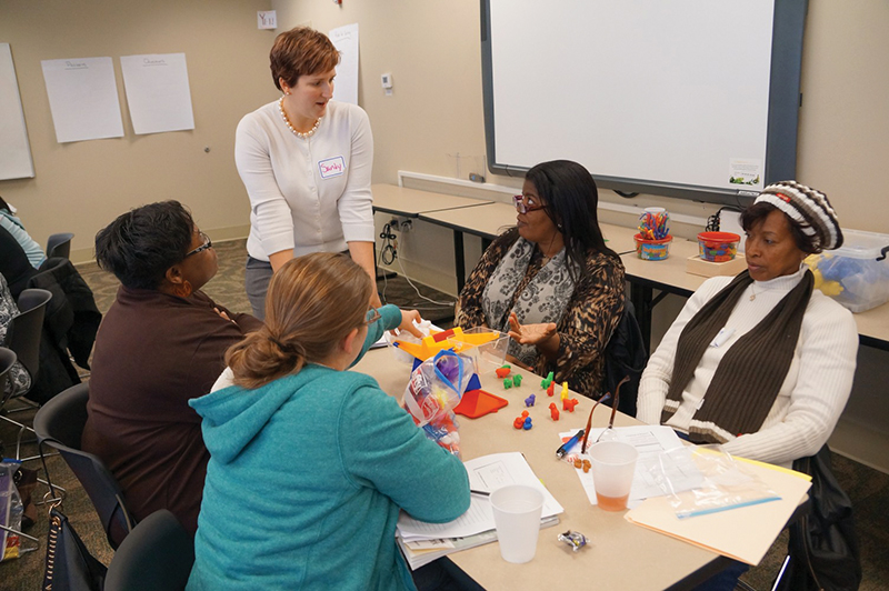 Professor Sandra Linder (standing) is helping lead the program to provide childcare teachers and home-based caregivers with skills that support mathematics learning among young children.