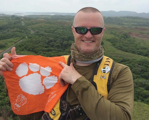 Micronesia Brad Blackburn '97 displays his Clemson pride with a Tiger Rag that traveled more than 22,000 miles to the islands of Pohnpei, Yap and Palau.