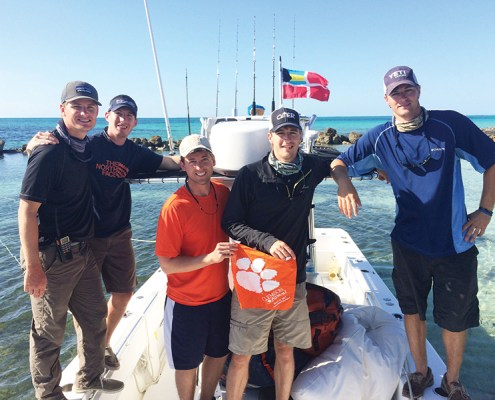 Bahamas Will Krause '11, Brian Lovelace '09, Scott Sampson '08, M '10, Chandler Martin '11 and Ryan Martin '11 take along a Tiger Rag for a fishing trip in the Abacos.