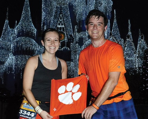 Florida Ginny Ahalt '11 and Michael Quandt '11 show their Tiger Rag at mile six of the 2015 Walt Disney World Marathon in Orlando.