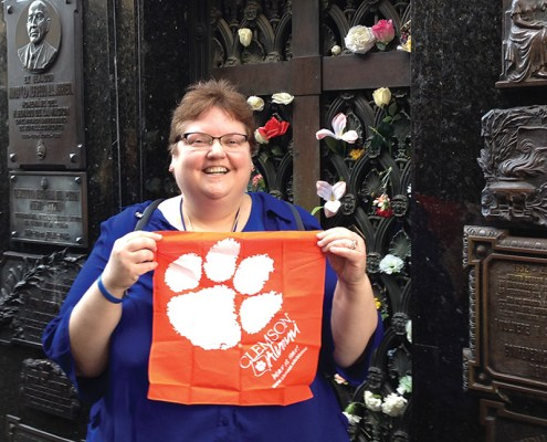 Argentina Carol Ferguson '88, M '91 shows off her Tiger Rag at Eva Perón's grave in Buenos Aires.
