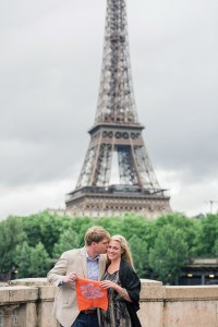 France Josh Culler '10 and Emily Campolong '11 celebrate their new engagement — with a Tiger Rag signed by Dabo Swinney — at the Eiffel Tower in Paris.