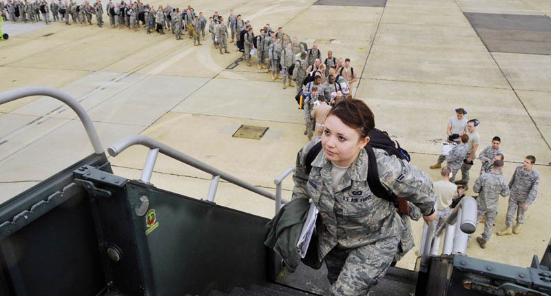 Airman 1st Class Claudia Segovia boards a Boeing 737 en route to Bagram Airfield, Afghanistan, in support of Operation Enduring Freedom. Airman Segovia is assigned to the 492nd Fighter Squadron at Royal Air Force Lakenheath, England. (U.S. Air Force photo/Airman 1st Class Eboni Knox)
