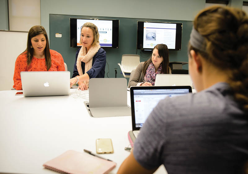 Fisk works with students in the Pearce Center.