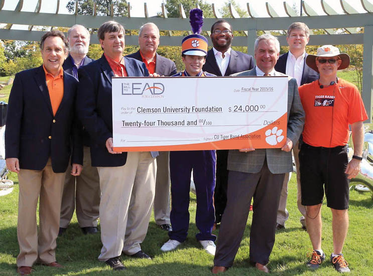 Pictured are (from front left) Richard Goodstein, dean, College of Architecture, Arts and Humanities; Tom Waldrop, CUTBA president; Drew Bismack, Tiger Band member and CUTBA student board member; Brian O'Rourke; associate vice president, University Advancement; and Mark Spede, Tiger Band director; (back left) Tony Stapleton, CUTBA founding member; Larry Sloan, CUTBA founder; LaRon Stewart, CUTBA board member; Walter Betsell, CUTBA board member.
