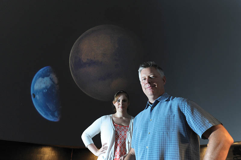 Psychology professors, Tom Britt and Marissa Shuffler at Planetarium in Kinard Hall.
