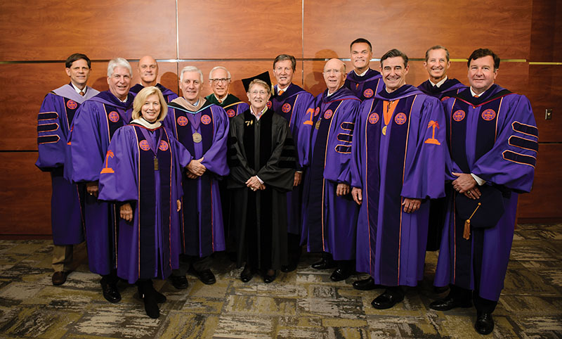 Jean Toal (center) with the Clemson University trustees.