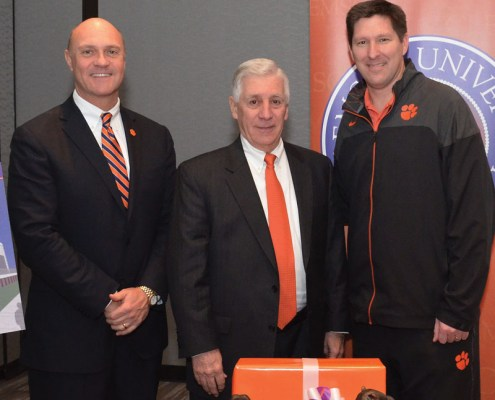 Joe Swann (center) with President Clements and Coach Brownell.