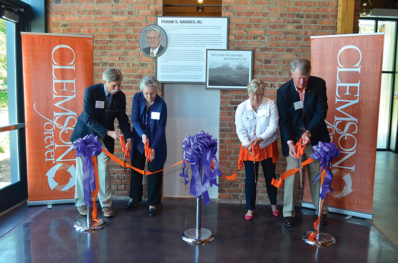Members of the Barnes family cut the ribbon for the Barnes Center.