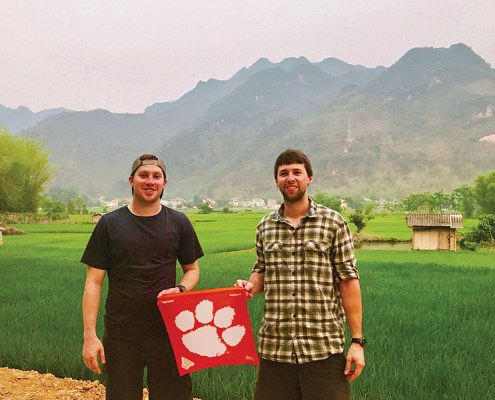 Tyler Youngman '13 and John Launius '11 show their Tiger pride while motorbiking through rural Vietnam.