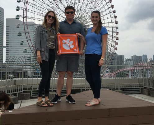 Megan Hoffman '13, Tate Fennell '11 and Lauren McDonald '15 in front of the giant Ferris wheel known as Cosmo Clock 21 in Yokohama, Japan.