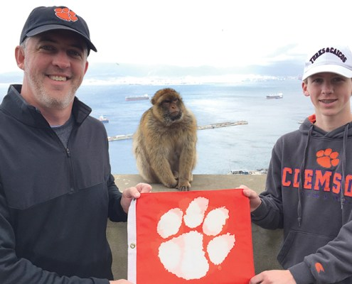 Alton McLellan '93 and Sam McLellan share their love of Clemson with a new friend in Gibraltar.