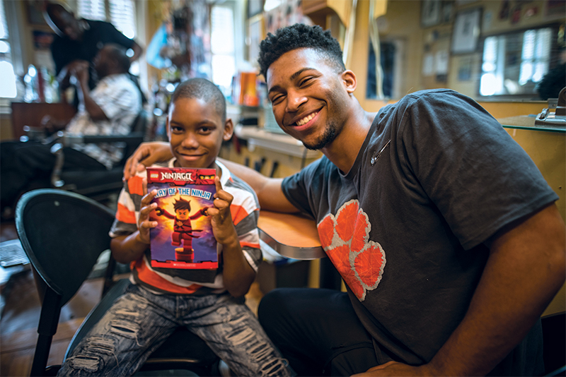 Student Deakin Rencher teaches reading to Tydarius Cobb