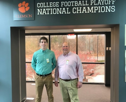 "Connecticut: Drew Hyde '84 and his son, Greg, toured ESPN headquarters in Bristol. ""In the National Championship hallway is a display of all the D-1 football teams' logos. You can press any of the logos and it will activate the playing of that school's fight song. Yes, we heard 'Tiger Rag'!"""