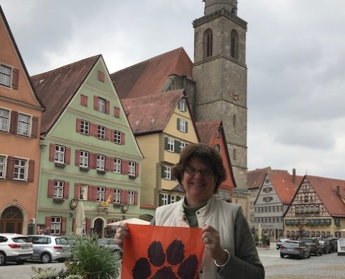 "Germany: Robin Lynn Kirk '78 and her husband, Bob, took a trip through Bavaria and snapped a shot with her Tiger Rag in Dinkelsbühl, Bayern, ""a medieval Imperial City with marvelous history and architecture and fabulous people!"""