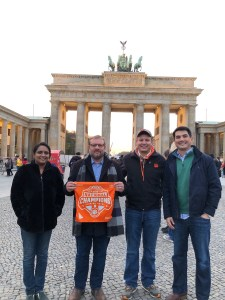 Germany: Jyothi Rangineni '09, Noah Chitty '00, Ryan Marino '07, Bill Griese '06 and Elizabeth Chitty '04 (not pictured) visited Berlin during the 30th-anniversary weekend of the fall of the Berlin Wall.