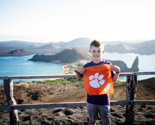 "Ecuador: Lindsay '03 and Kevin '03 Thalinger took their kids, Addyson and Jackson (pictured), on a trip to the Galápagos Islands in the Pacific Ocean, where they saw giant tortoises and swam with a whale shark: ""They say it is a one-in-a-million chance for that to happen!"""