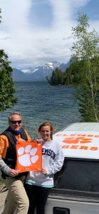 """Montana: Serena A. """"Sallie"""" Spencer '21 and Curtis M. Spencer '83 left for a cross-country road trip to """"celebrate and enjoy the western United States"""" the day after Sallie's graduation from Clemson. They took out their Tiger Rag for a photo op at Glacier National Park."""