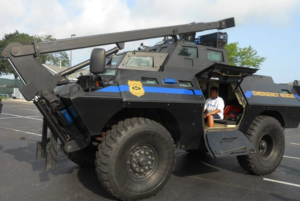The children got to sit in the S.W.A.T. truck and visit with the officers.