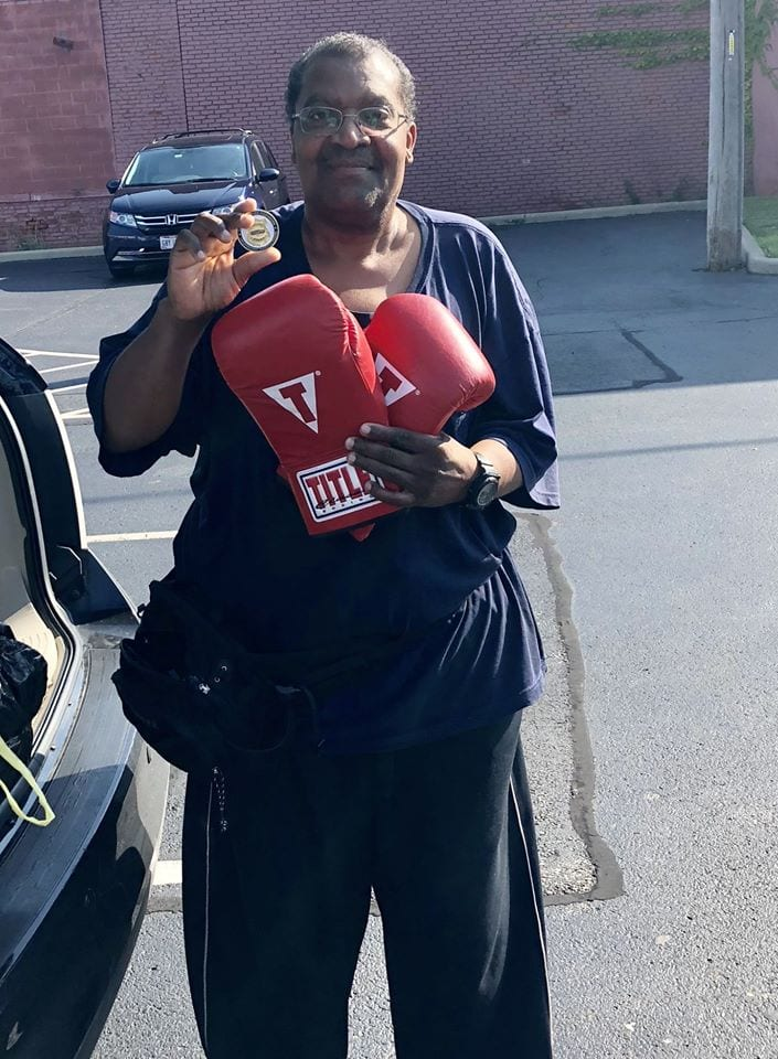 Officer Maurice Hamilton donation of boxing gloves