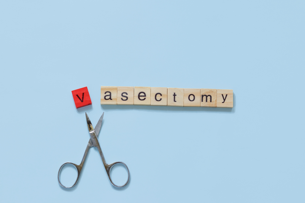 the word vasectomy made with wooden tiles on a blue background