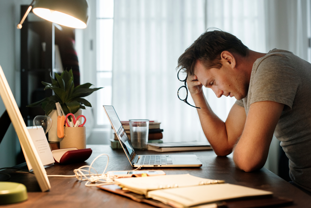 man at his desk stressed