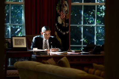 Picture of President Barak Obama at the resolute desk, 2013
