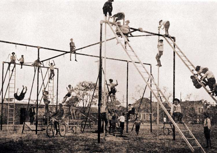 Children in 1900 on iron pole playground equipment at Trinity Play Park - Dallas