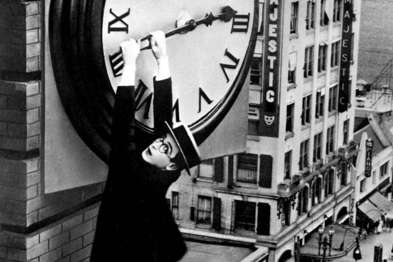 Harold Lloyd Safety Last hanging from the clock