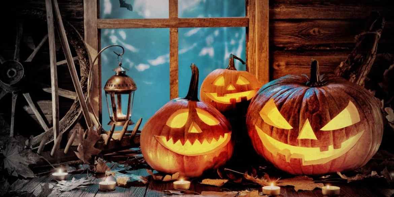 History of Halloween - glowing Jack O lanterns - carved pumpkins