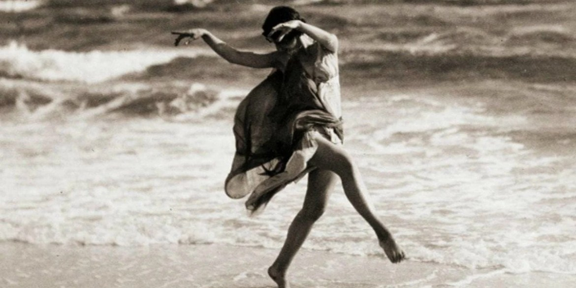 Isadora Duncan dancing on the beach