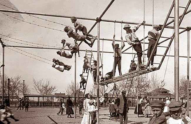 Kids doubled up on vintage playground swings