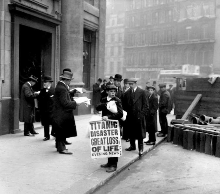Newsboy selling the Evening News newspaper after the loss of the Titanic - 1912