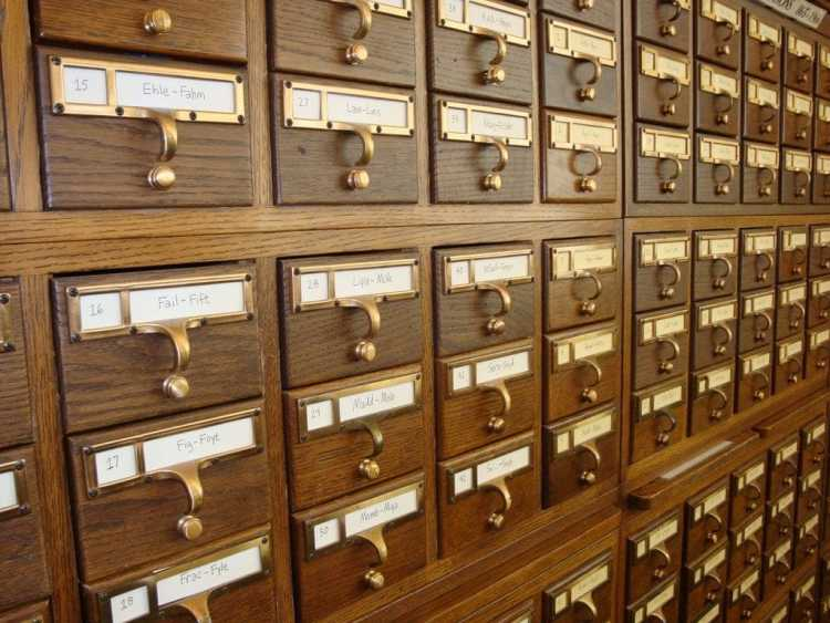 Wooden card catalog with brass handles