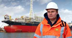 Man offshore oil lookng to horizon