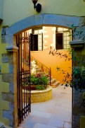 Peaking into the courtyards in Chania