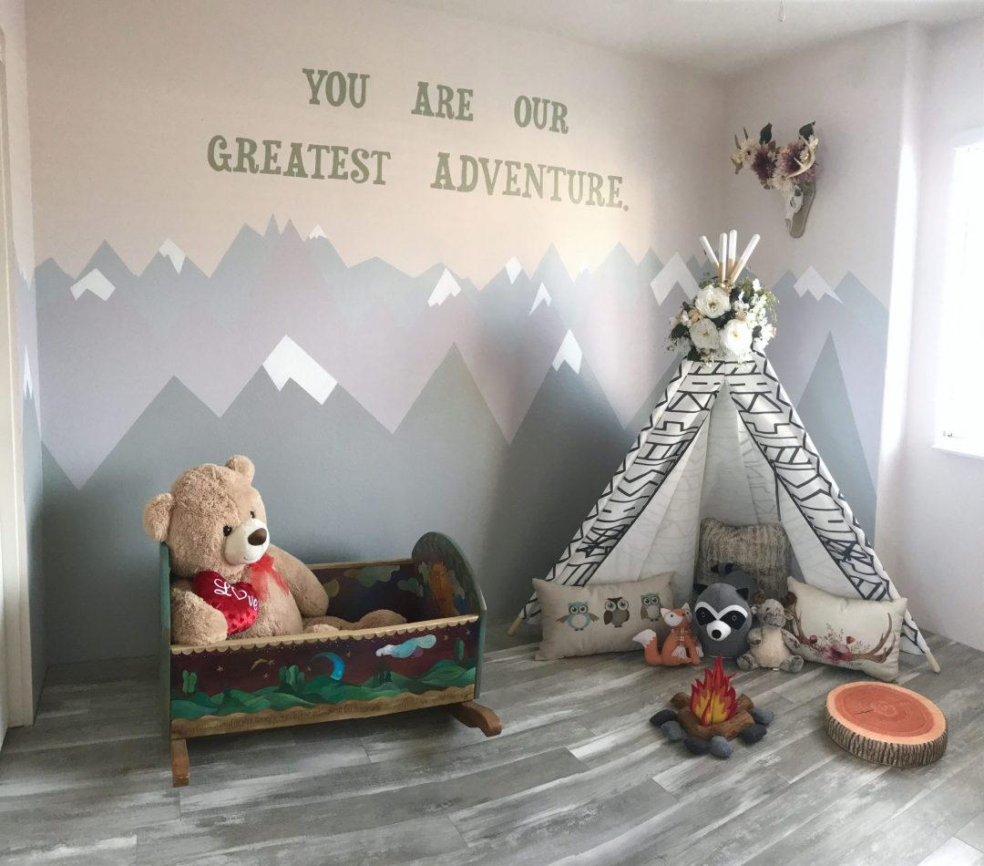 woodland tribal playroom theme with teepee and mountain